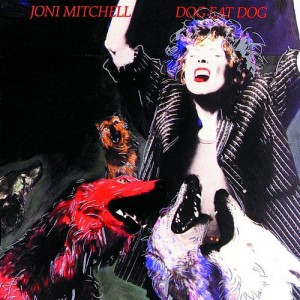 Copertine Bestiali ; Dog Eat Dog – Joni Mitchell